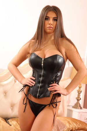 Solo model Sarah James bares her hooters in leather boots and fetish gear