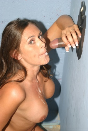 Busty chick Simone Riley gets naked before sucking off a dick at a gloryhole