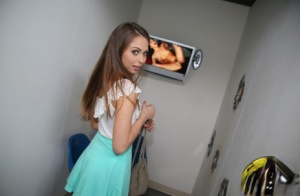 Young Riley Reids hairy upskirt leads to a mouthful through the gloryhole