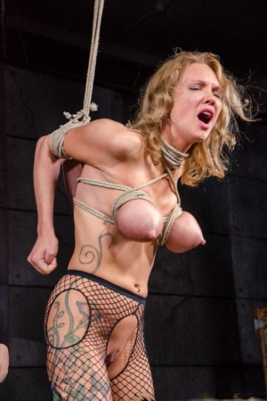 Busty blonde Rain Degrey is thoroughly debased by a female in a dungeon