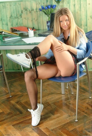 Blonde teen with nice tits works free of school uniform to pose nude