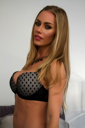 Hot MILF Nicole Aniston proudly display her big boobs on top of her bed 71421657