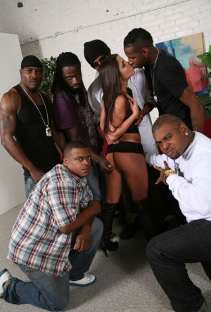 Hot beauty Giselle Leon in high boots gets cum on tiny tits in black gangbang