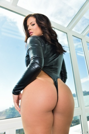 Top pornstar Keisha Grey shows off her sexy ass in thong and latex jacket