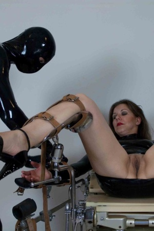 Bottomless female sex slave is machine fucked while strapped to gyno chair 10406543
