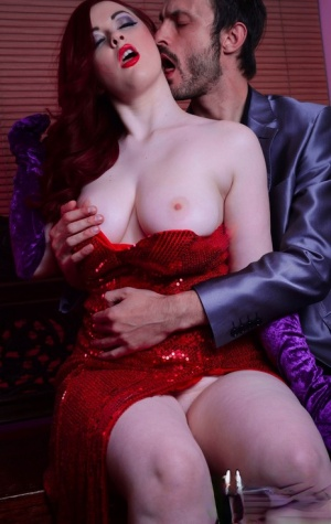Redhead Jessica Rabbit wannabe Jaye Rose bares her nice tits before giving BJ