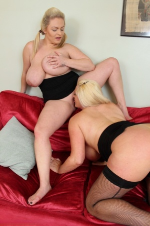 Fat British women with pinned back blonde hair go lesbian on a sofa