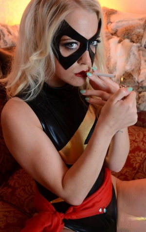 Blonde model Xena Wilkes finger fucks after a smoke while wearing a mask