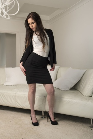Solo model Amber Nevada strips off business attire and lingerie to pose nude