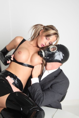 Hot Lara Love in pigtails  latex gets an office fuck from a guy in a gs mask