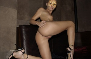 Blonde chick models in the nude in building lobby wearing a mask
