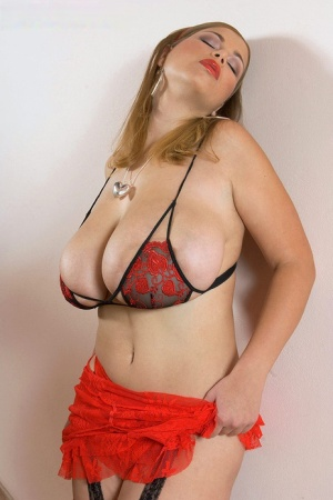 Hot chubby Terry Nova in sexy red lingerie flaunting her enormous big tits