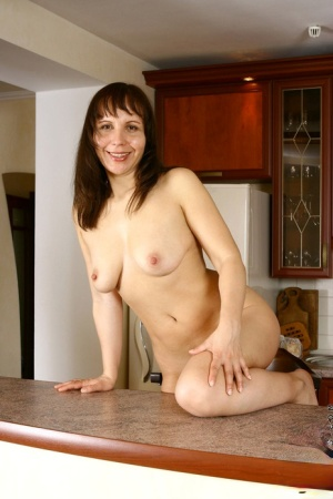 Older housewife Lana covers her naked tits and ass in cream on kitchen island