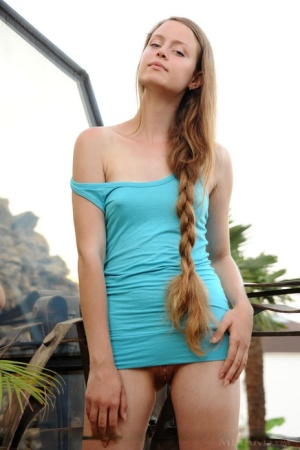 Long haired Milana K in mini dress on knees showing hot ass on the steps
