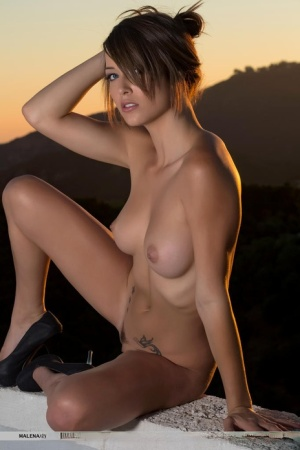 Glamour girl Malena Morgan gets naked on a balcony in a confident manner