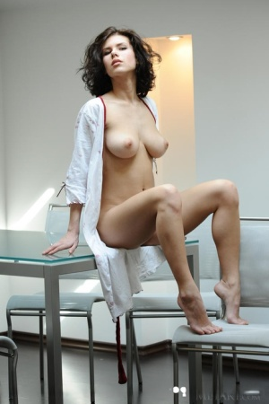 Hot raven-haired model Elsa uncovers her perfectly round big boobs