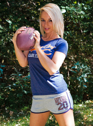 Blond amateur Nikki Sims gets naked in the backyard while handling a football