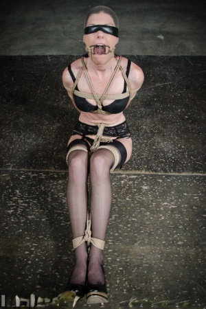 Dark haired female India Summer finds herself bound with rope in a dungeon 74320414
