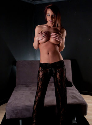 Amateur girl Nikki Sims covers her naked tits after disrobing to a black thong