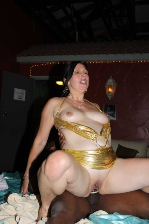 UK slut in a gold swimsuit gets gangbanged by black and white cocks