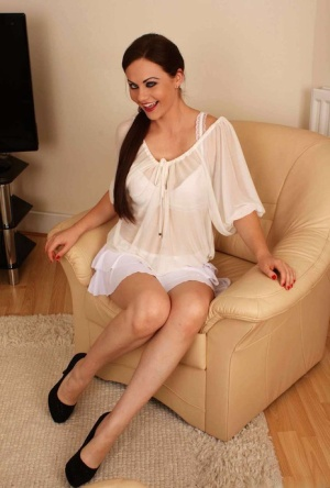 Hot chick Tina Kay slips cotton panties over great legs as she disrobes