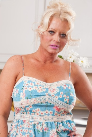 Thick older housewife Roxie Doll teases her nipples after disrobing in kitchen