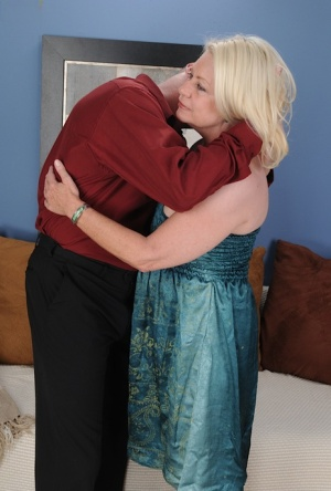 Blonde grandmother Angelique is stripped of her clothes before riding a cock