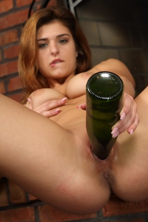 First timer Leah Gotti attends to bald pussy with wine bottle and candlesticks