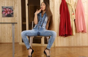Jeans clad Stefany wets herself and drinks the pee before toying with dildo