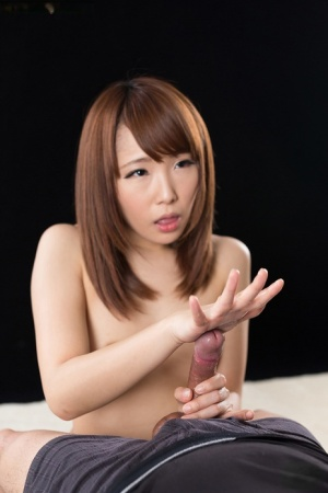 Sexy little Japanese girl on her kness spreading  giving a hot handjob