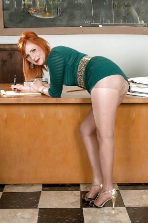 Redhead teacher in nylon pantyhose Sasha Brand toying her twat in the classroom