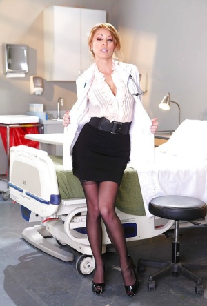 Voluptuous doctor Monique Alexander strips to stockings and spreads