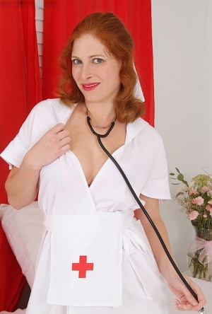 MILF redhead nurse undressing off her uniform to tease her wet pussy