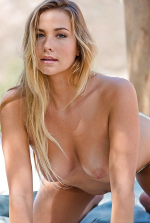 Stunning blonde undressing and teasing her honey pot outdoor