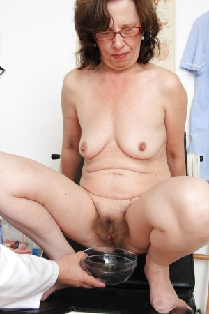 Ugly mature lassie in glasses gets her pussy examed by a naughty gyno 14726389