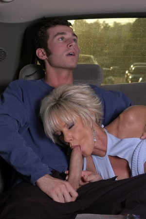 Slutty mature blonde goes down on a young meaty pole in the car