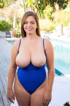 Curvy chick in blue swimsuit uncovering her ravising massive jugs