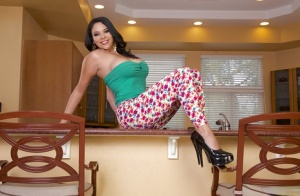 Big busted latina lady in snazzy leggings undressing in the kitchen
