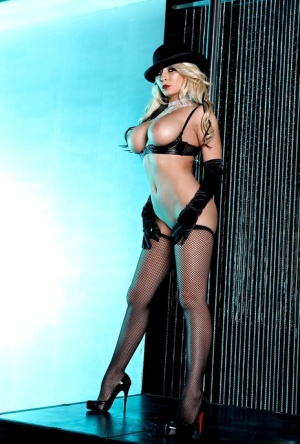 Stylish stripper babe Madison Ivy flaunting topless in stockings