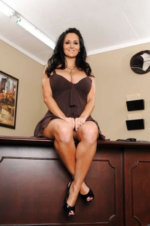 Mature mom Ava Addams shows off massive tits and spreads pussy