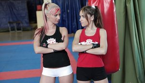 Sporty lesbian chicks have some non nude catfight fun in the ring