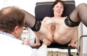 Fatty mature gal with massive melons goes through her gyno examination 29623130