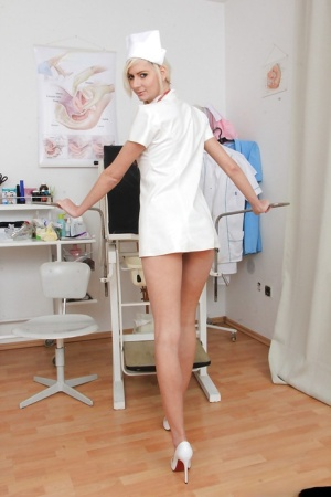 Simone is a skinny nurse that loves masturbating her shaved pussy 63160265