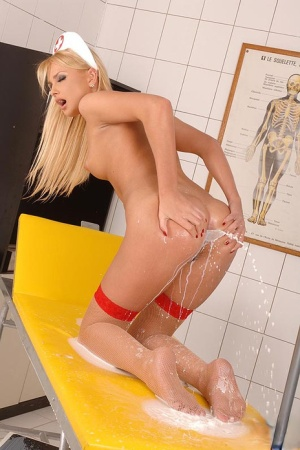 Hot nurse in sexy uniform and stockings Ivana Sugar takes a milk enema