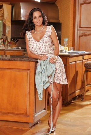Big tits milf Ava Addams is undressing her dress while in a kitchen