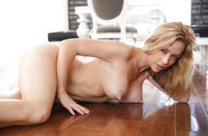 Undressing babe with big tits Kayden Kross is showing her ass