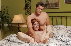Slender redhead Penny Pax enjoys pussy licking while in her glasses