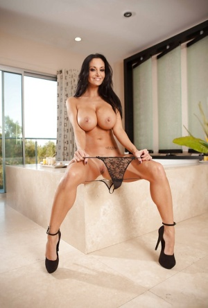 Milf wife Ava Addams is teasing her big natural tits in lingerie