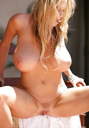 Clothed amateur Kelly Madison spreads her long legs in high heels