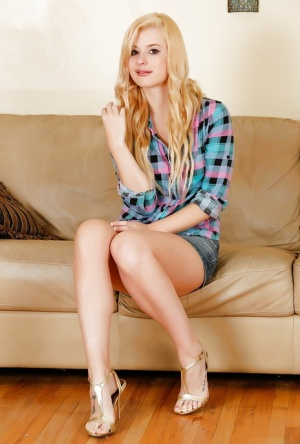 Undressing blonde teen Charlyse Angel demonstrates her long legs